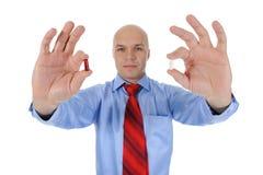 Tablettes rouges et blanches dans des mains mâles Photos libres de droits