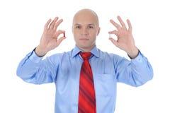Tablettes rouges et blanches dans des mains mâles Photo stock