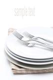 Tableware для обедающего - плиты и вилки, изолированный на белизне Стоковая Фотография