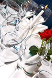 Tableware. Table with glasses, candle etc Stock Photography