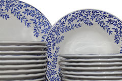 Tableware. A white tableware decorated with blue flowers in the closet Royalty Free Stock Image