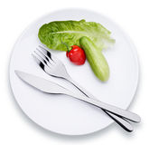 Tableware. And some vegetable, a studio shot Royalty Free Stock Photos