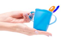 Tableware for baby food in female hands isolated Royalty Free Stock Photography