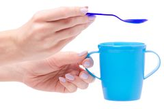 Tableware for baby food in female hands isolated Stock Photos