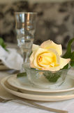 Tableware in beige. With yellow roses Stock Photography
