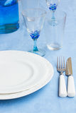 Tableware on blue cloth Royalty Free Stock Images