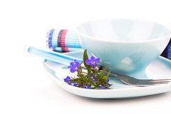 Tableware with blue lobelia flowers and cutlery Royalty Free Stock Photography