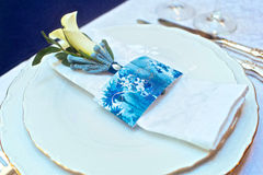 Tableware with blue and yellow flowers on table Royalty Free Stock Photo