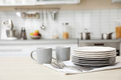 Tableware and blurred view of kitchen interior. On background stock photography