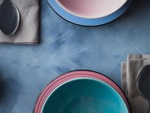 Tableware for breakfast or lunch on blue Royalty Free Stock Image
