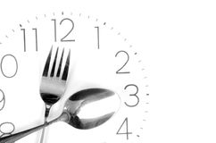 Tableware on clock face Royalty Free Stock Images