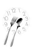 Tableware on clock face Royalty Free Stock Photography