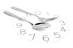Tableware on clock face Royalty Free Stock Photos