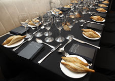 Tableware and cutlery on a table. Stock Photography