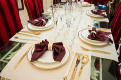 Tableware on dining table Stock Photos
