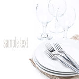 Tableware for dinner - plates, forks and glasses, isolated Stock Photography