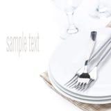 Tableware for dinner - plates, forks, glasses, selective focus Stock Photo