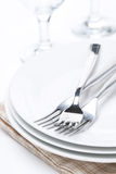 Tableware for dinner, plates, forks and glasses, selective focus Royalty Free Stock Photos
