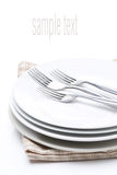 Tableware for dinner - plates and forks, isolated on white Stock Photography