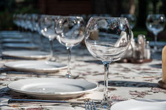 Tableware. Empty footed tumblers,glasses and party plates on festive served table Stock Photo