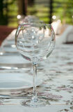 Tableware. Empty footed tumblers,glasses and party plates on festive served table Stock Photography