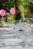 Tableware. Empty footed tumblers,glasses and party plates on festive served table Stock Photos