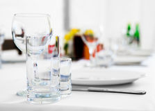 Tableware and glasses Stock Images