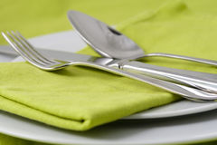 Tableware on green Stock Images