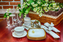 Tableware and jasmine flowers. close-up Royalty Free Stock Images