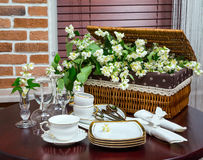 Tableware and jasmine flowers in the interior Stock Photography