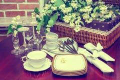 Tableware and jasmine flowers.vintage Stock Photo