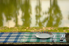 Tableware. Knives and plate on the table outdoor Royalty Free Stock Image