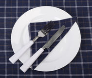 Tableware on a napkin Stock Images