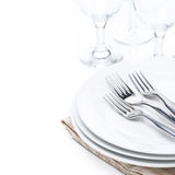 Tableware - plates, forks and glasses, isolated. On white Stock Photo
