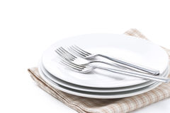 Tableware - plates, forks on napkin, isolated Royalty Free Stock Image