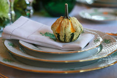 Tableware and pumpkin of the dining table. Scene of the room of tableware and the pumpkin of the dining table Royalty Free Stock Photo
