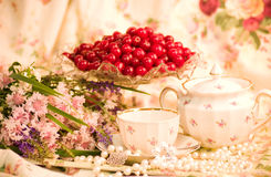 Tableware, raspberry, cherry and flowers Stock Photos