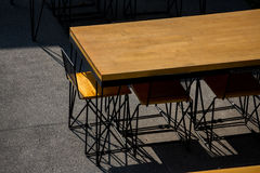 Tableware. Restaurant furnishings and tableware in a brightly lit outdoor area Stock Photography