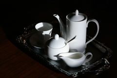 Tableware service. White porcelain coffee set of dishes. chrome tray stock photography