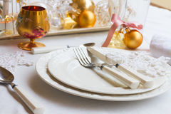 Tableware set for christmas. Set of plates, cups and utencils with golden chrismas decorations Stock Photo