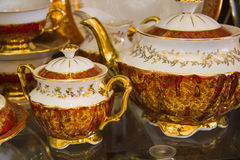 Tableware set with red ornate Royalty Free Stock Photography