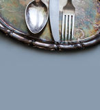 Tableware set on the vintage silver tray. Royalty Free Stock Images
