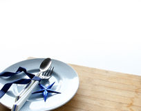 Tableware with shiny blue star Royalty Free Stock Images