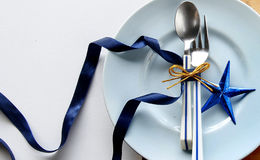 Tableware with shiny blue star Royalty Free Stock Photos