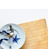 Tableware with shiny blue star Stock Photos