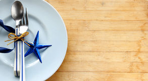 Tableware with shiny blue star Stock Image