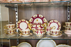 Tableware in showcase Royalty Free Stock Photo