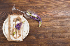 Tableware and silverware with puffy violet lupins Stock Image
