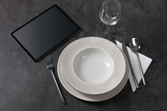 Tableware with tablet concept. Stylish tableware with tablet conceptn stock photography