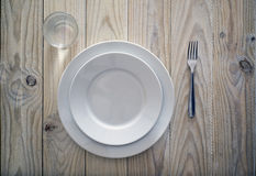 Tableware. On wooden table. grazing lighting Stock Image